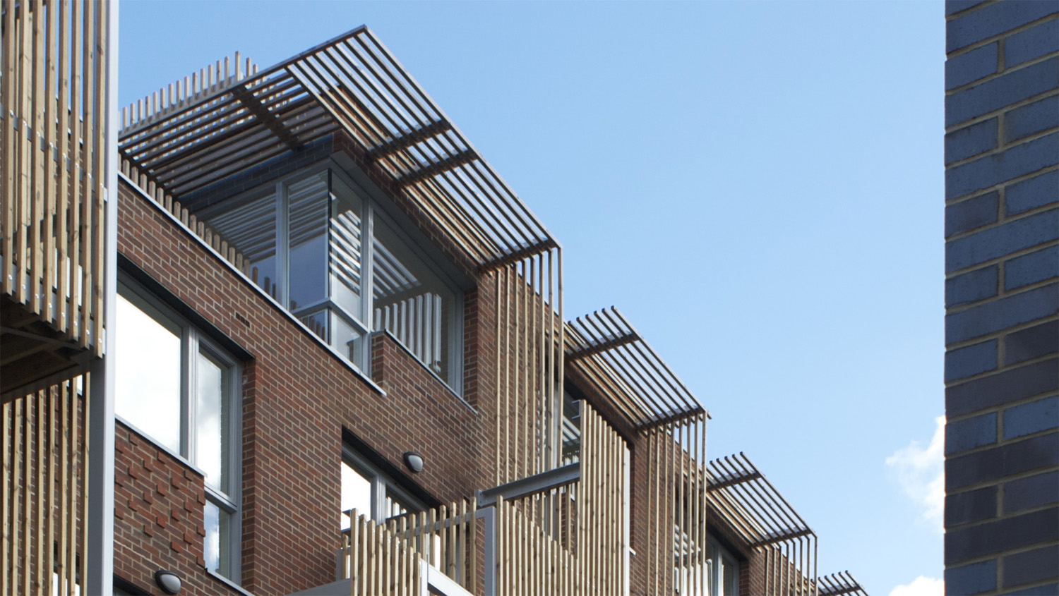 New-build comprising 33 flats over four to five storeys, with a shared rooftop terrace.