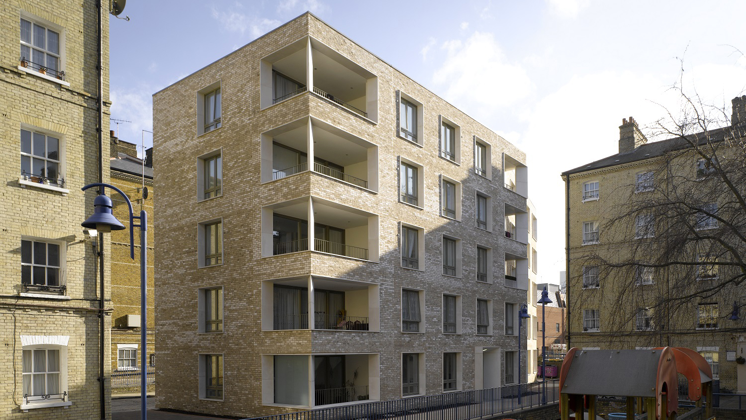 A new-build block comprising 13 apartments around a newly created courtyard garden.