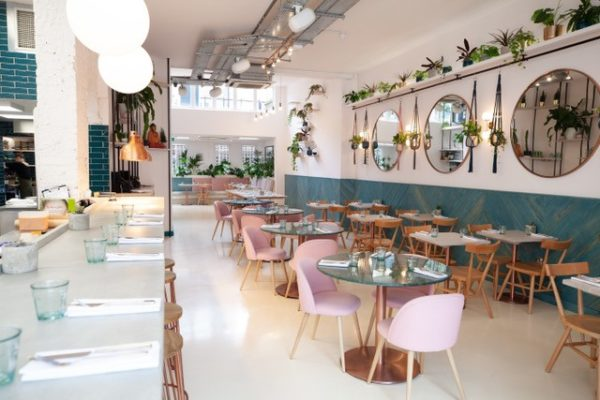 The ground floor and basement of a double-fronted building were adapted to create space for this vegan restaurant.